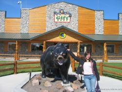 Joann and bear statue at Yellowstone Bear World.jpg